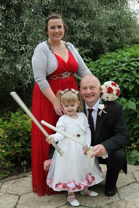 Flower girl Skye preferred the light saber to her flower girl wand!