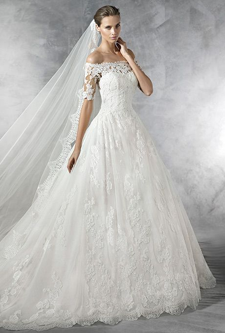 Pronovias. Off-the-shoulder princess-style dress.  Elbow-length, sheer sleeves with lace appliqu�s. Sheer back with appliqu�s. Tulle and lace skirt with gathers at the waist.