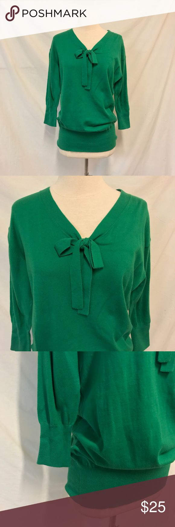 CAbi Lucky Pullover Tunic Sweater Style 822 Size M CAbi. Size medium. Lucky pullover Tunic Sweater. Kelly green color. Long Sleeve. Ribbed hem and slouchy Top. Bow tie at the neckline. Long Sleeve. Lightweight material. Not lined. Excellent used condition with no signs of wear. Bust: 21 inches. Length: 31 inches. ALL MEASUREMENTS ARE TAKEN WITH ITEM LAYING FLAT. 100% cotton. ||1223|| CAbi Sweaters