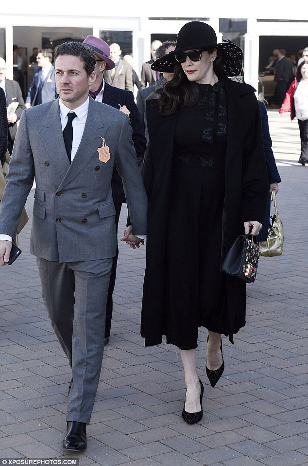 Hand-in-hand: The couple arrived at the prestigious annual horse-racing event holding hand...