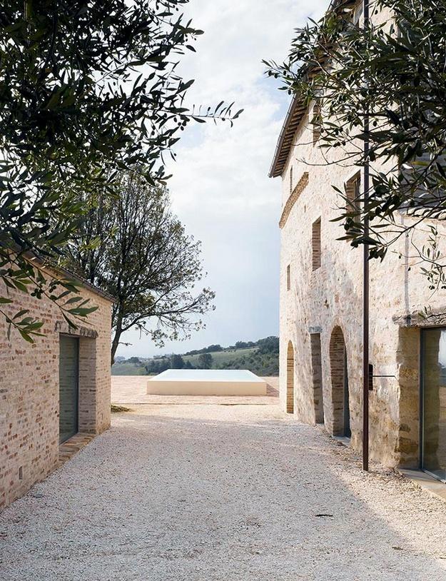 Olive trees, old stone, modern pool.....Le Marche Villa in Treia by Wespi de Meuron Architekten