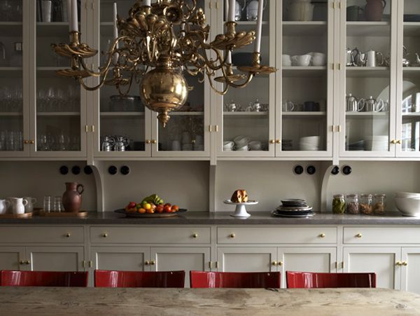 Ilse Crawford Ett Hem Stockholm kitchen, gray cabinets, red chairs, brass chandler