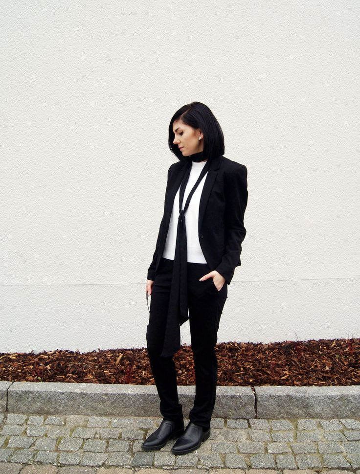 style blogger mesmerize wearing our black lace suit