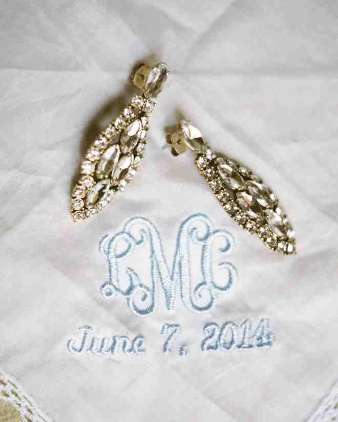 The bride topped off her ensemble with a pair of antique-style earrings from J.Crew.She carried two embroidered handkerchiefs: one belonging to her grandmother and another from a longtime friend, which had a monogram of her initials and the wedding date in blue.