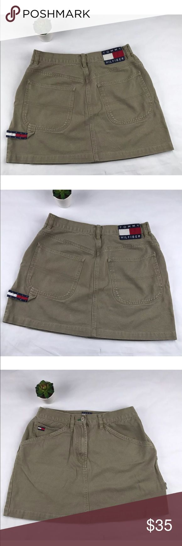 Vintage Tommy Hilfiger women's pocket mini skirt women's vintage tommy Hilfiger pockets short skirt olive green, SZ/12 pockets on front and back gently worn small  flaw on inside tag not visible  Please see pictures for further details.  waist around 29''  length 16''  Thank you for looking!! Tommy Hilfiger Skirts Mini