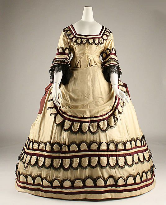 Dress, ca. 1868.  Striking colors and really intricate detailing. This dress would have made an entrance at the ball.