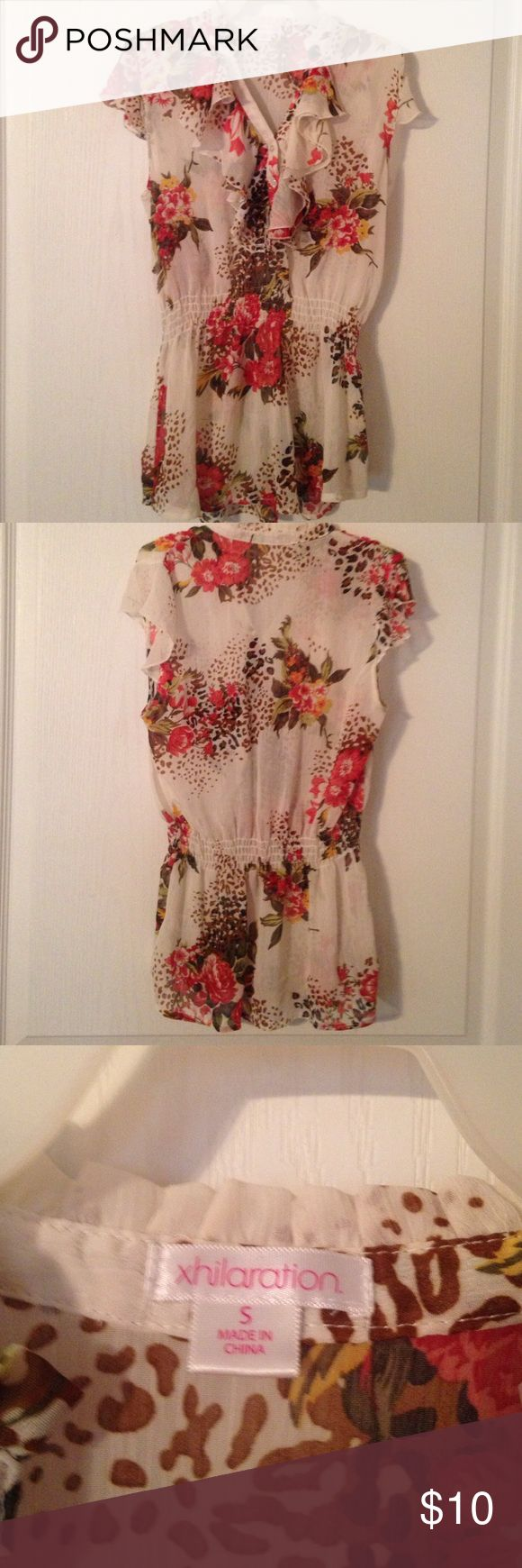 Floral Shirt Floral shirt size Small. Elastic cinched around waist. Very sheer with ruffles and cap sleeves. There are two buttons. Xhilaration Tops Blouses