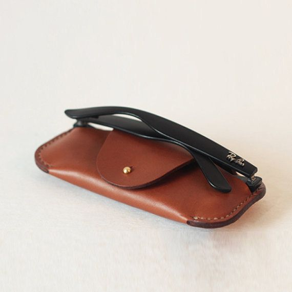 Leather sunglass holder. Protects the lenses but adds far less bulk than a usual sunglass case. $29.99
