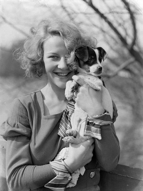 Adore her cuffs! (And the puppy is cute too!) | via Nationaal Archief