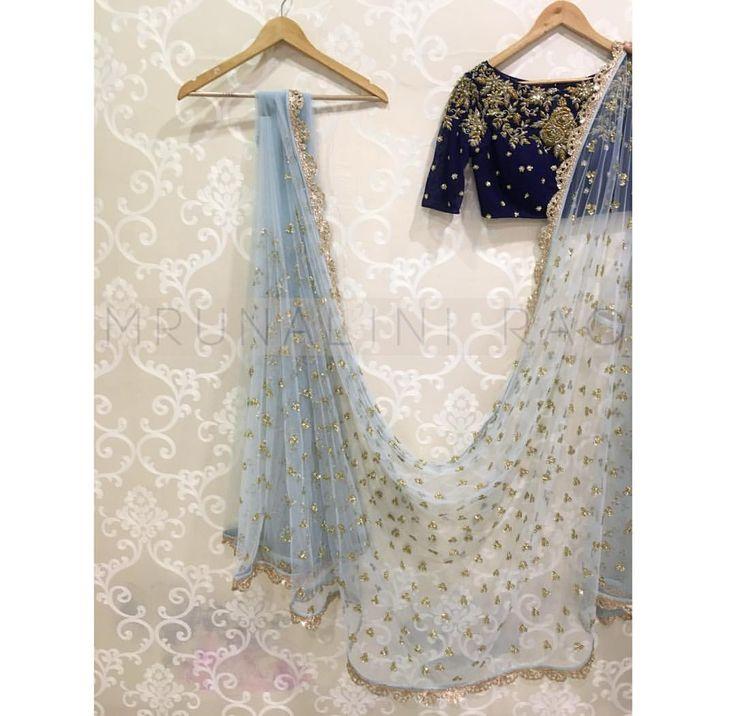 Beautiful sky blue color designer saree with royal blue color designer blouse from Mrunalini Rao. 21 June 2017