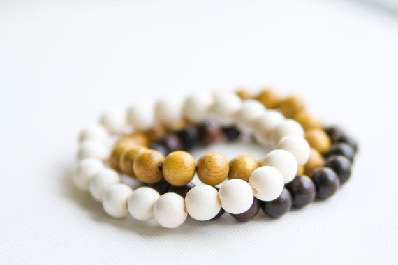 Wooden Beaded Bracelet  This handmade beaded bracelet is made with 10mm beads and durable elastic jewelry cord and can easily fit up to 6 - 8 wrist.