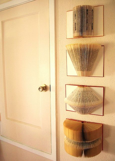 Old books as (wall) art. Seemed a sin at first, but if they are unreadable why not create something beautiful? Great for a library or office!