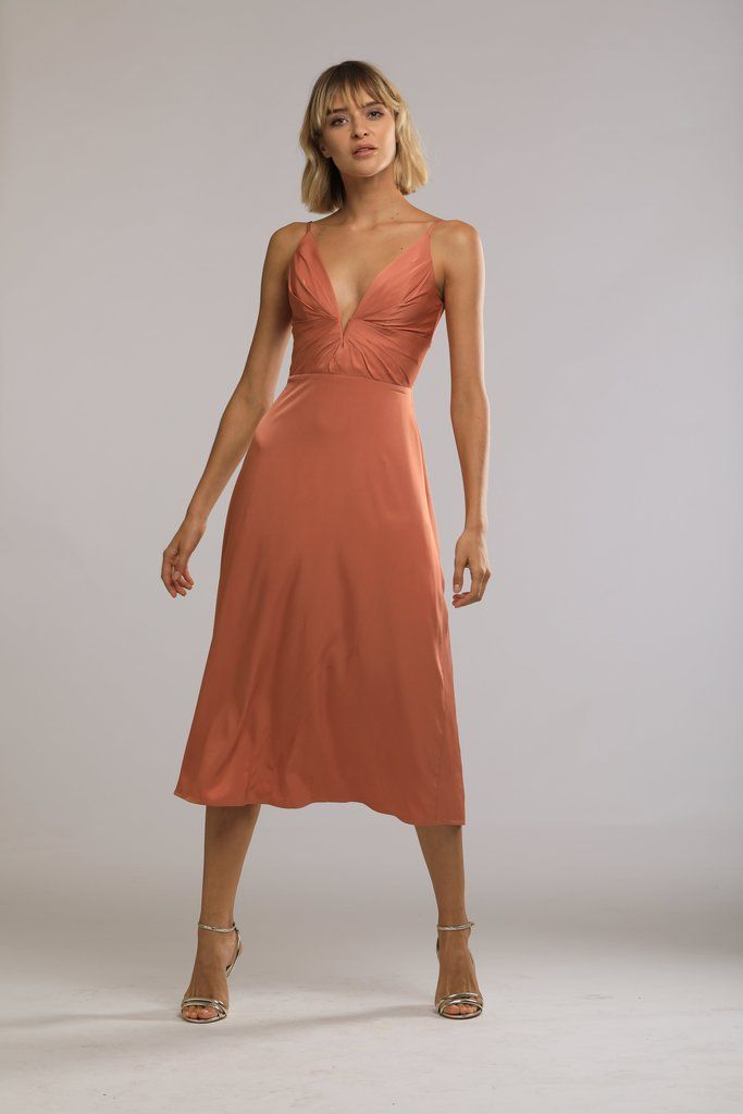 654002e0a33 Terracotta midi dress with plunging V-neck. Perfect for a Fall wedding  guest look. Shop now at www.sau-lee.com