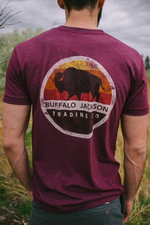 Super soft graphic pocket tee shirt for men (aka the Frocket) by Buffalo Jackson Trading Co. This retro sunset crew neck tshirt is one of our most popular clothing products and is perfect for men with simple, fun, casual style. Pair it with shorts, and you've got your go-to outfit for the summer.