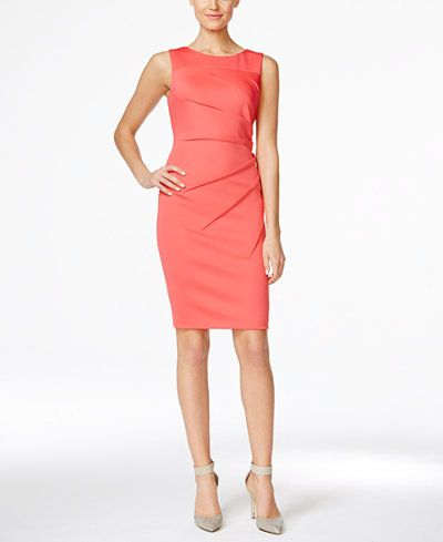 This elegant sheath dress from Calvin Klein is a perfect pick for the office this season. | Polyester/spandex | Dry clean | Imported | Crew neckline | Zipper closure at back | Sleeveless | Sunburst de