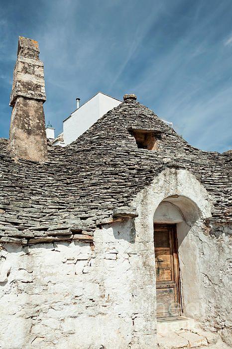 Old Trullo house under a blue sky in Alberobello, Puglia, Italy