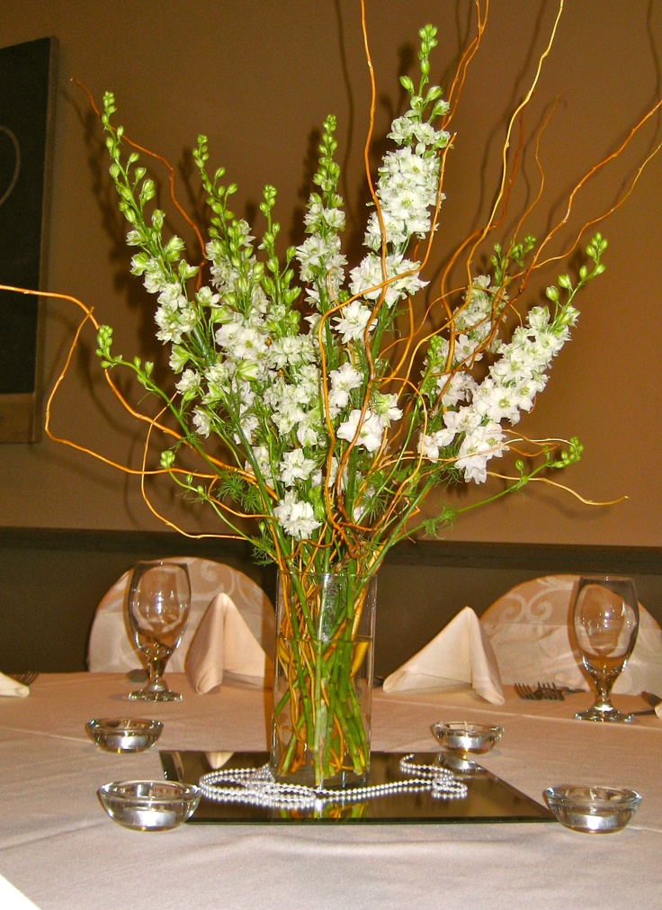 Tall wedding centerpiece with curly willow and larkspur. Flowers for weddings and events by Flor by Melissa; currently serving the DFW metroplex.