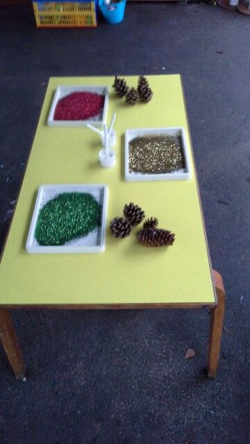 Glitter, glue and pine cones to make pretty decorations