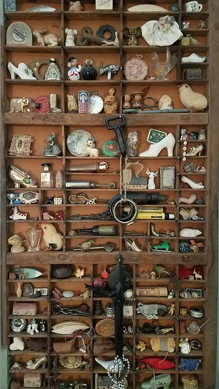 Tiny vintage collection of treasures in printers drawer display