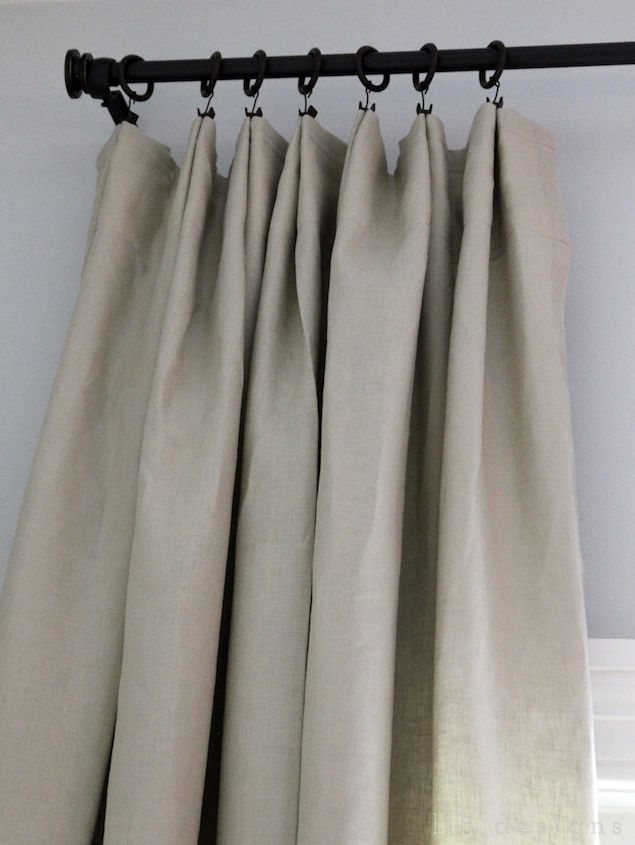 the way to fake a pleat: ring clips! No sewing required. Just pinch and clip. {Linen curtains from Ikea; rods from Target. Very budget friendly!}