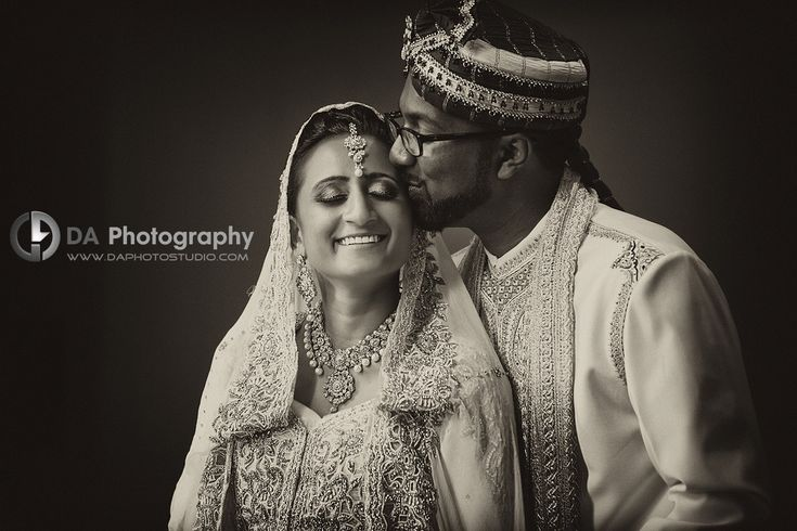 Bride and groom at the reception in black and white