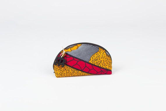 Make-up bag of colorful african wax fabric full of Adinkra symbolism from Ghana by the symbol love special to give as a birthday present