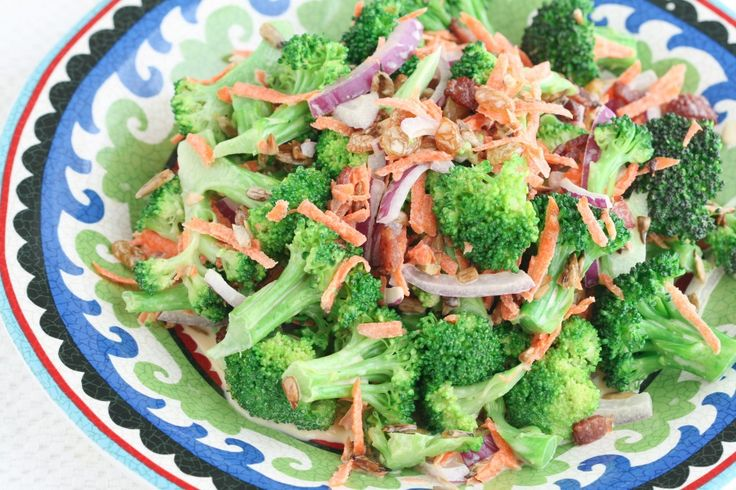 Healthier Broccoli, bacon, raison Salad: 1/2 red onion, thinly sliced 1/2 cup raisins 1/4 cup orange juice 1 large head broccoli, cut into bite-size pieces 6 pieces bacon, cut into small pieces 1 cup mayonnaise (click here for a homemade mayo recipe) 2 tablespoons honey (I prefer clover) 1 tablespoon cider vinegar 1 cup shredded carrots 1 cup dehydrated sunflower seeds or pumpkin seeds (I used a combination of both) Celtic sea salt