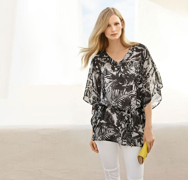 Printed caftans: A black-and-white caftan, white trousers and a colour-pop clutch make a perfect going-out statement… think post-work drinks, or al fresco dining on a warm spring evening. Wear your hair down in loose waves to finish off this easy yet striking look.