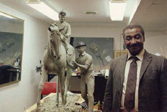 Eddie Sweat with a model of a future Secretariat statue, a statue he was thrilled to be part of!