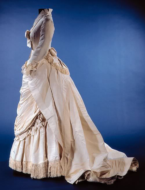 House of Worth, Silk Dress with Fringe Trim, Paris, 1870s. Look at the little bow at the back, above the train and bustle.: