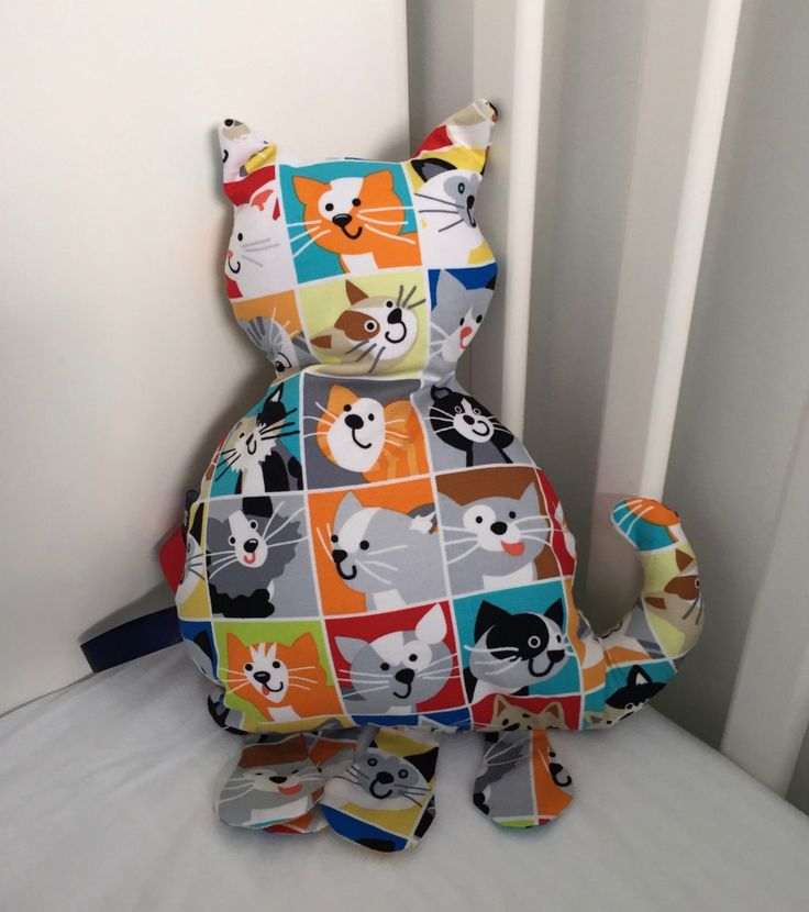 Cat shaped sensory label toy, pillow and stuffed animal in one