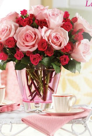 Gorgeous pink & fuchsia roses in a rose tint vase-wouldn't these beautiful on a Holiday table!