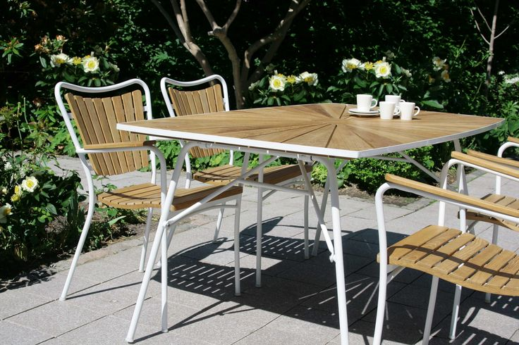 Scandinavian retro - dining set from Mandalay Denmark.  Marguerit folding table, L144cm, and stackable chairs. All with teak and aluminium frame.  Design by Mandalay Denmark please visit www.mandalay.dk
