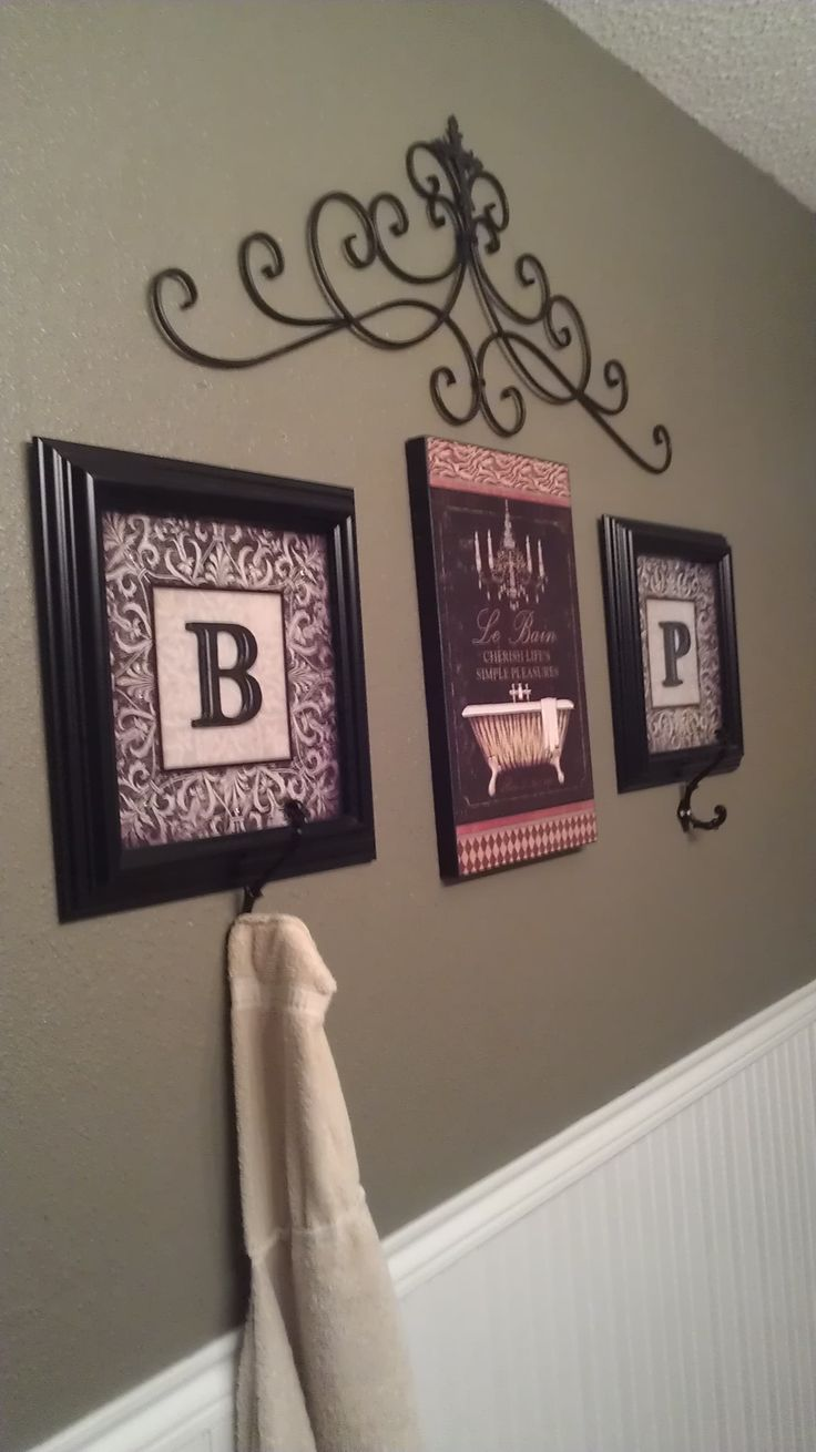 Initial towel hooks in my girl's bathroom!  I'd have to put mines full initials or names. Still cute!!