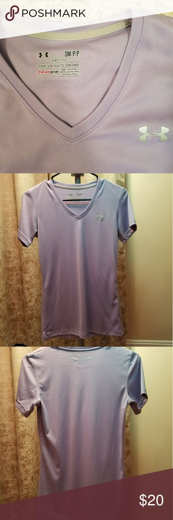 Under Armour women's V-neck Women's Under Armour heat gear short-sleeve V-neck. Really pretty lavender with silver symbol.  Great condition.   100% polyester Under Armour Tops Tees - Short Sleeve
