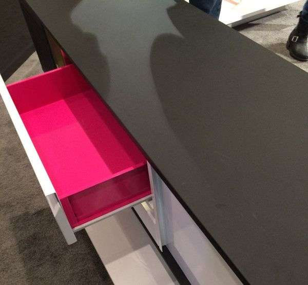 Sauder plays peek-a-boo with hot pink drawers.