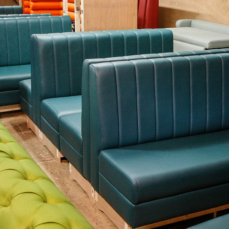 Back to back petrol blue fluted booth seating for What is banquette seating