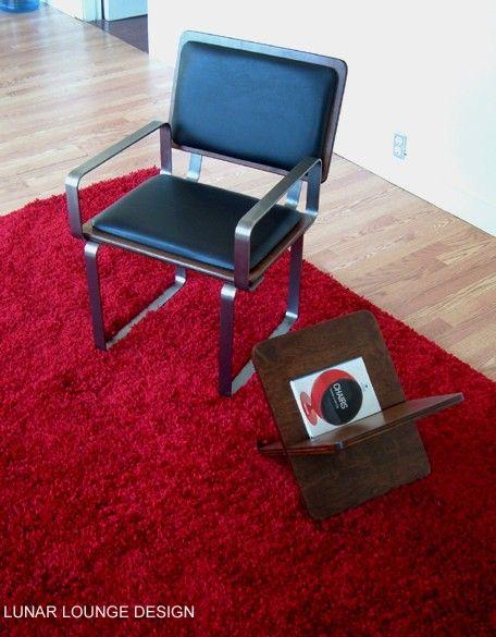 Ply Bak Arm chair shown in Black upholstery over Dark walnut finish.  Also shown is my Argyle Mag Rak in matching dark walnut finish.  http://etsy.me/2CIKv7K #furniture #chair #office #woodloungechair #Winnipegdesign #midcenturymodern #Canadiandesign  #lunarlounge