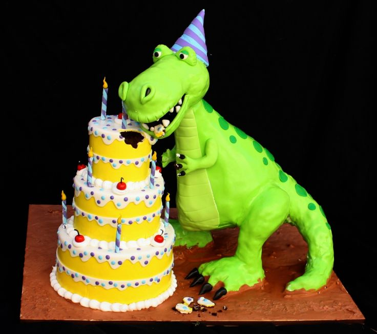 Very Hungry Dino - Everything is cake except for the dino's head,tail and legs. His body and the 3 tier b-day cake is all chocolate cake.