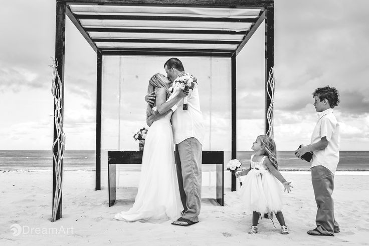 Newlyweds after the ceremony at #PlayacarPalace @palaceresorts @prweddings Photo by #DreamArtPhotography #DreamArtWeddings #Photography #BlackandWhite #Wedding #Bride #Groom #Mexico #RivieraMaya #Kiss #Kids Special thanks to @prweddings