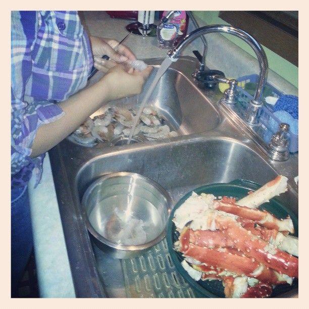 Rain helping Mami in the kitchen Saturday night. Brussel sprouts. Prawns. Alaskan King Crab Legs. Yum!