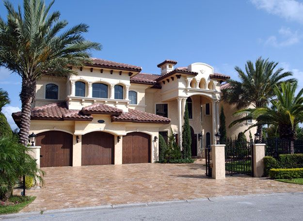 Grand Spanish Mediterranean style home with 6 bedrooms and 7100 square feet.  Spanish Mediterranean House Plan # 611095.
