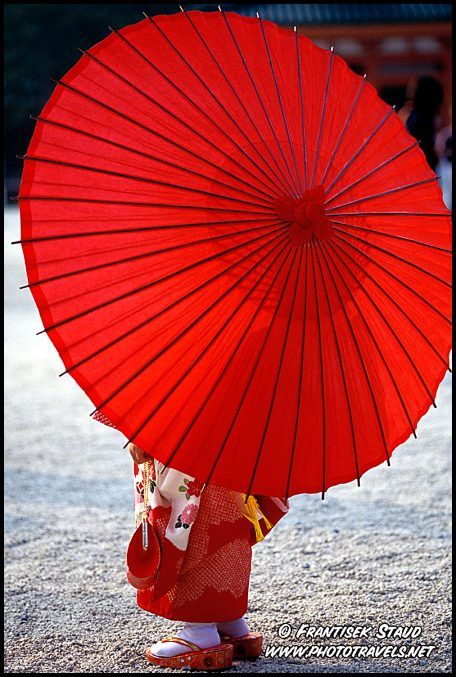 Little Maiko girl posing with #red umbrella in Heian Jingu Shrine, #Kyoto, #Japan Photo Ref. No: geisha-p-011 All images are copyrighted by Frantisek Staud