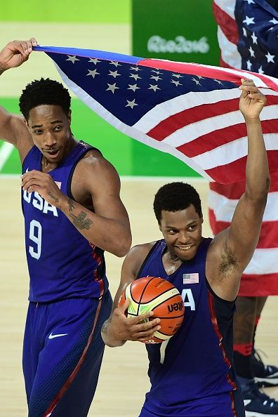 USA's guard Demar Derozan and USA's guard Kyle Lowry celebrate with USA's flag…
