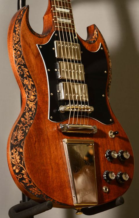 Gibson SG Custom Engraved... like the alignment and balance of the exposed pole-pieces of the pickups