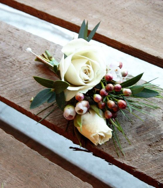 Beautiful corsage with Hypericum berries. Would love this in a wrist version for mothers of the bride and groom.