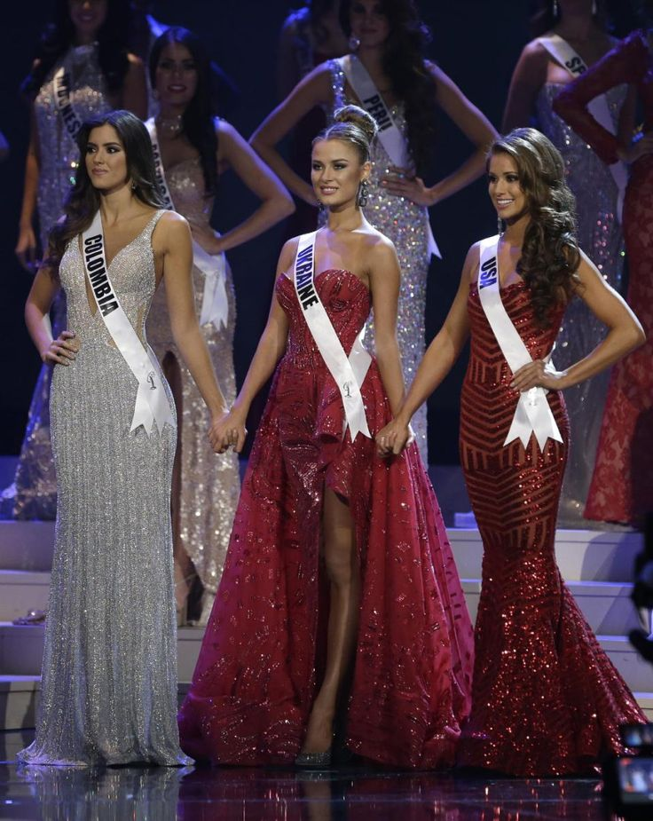 Miss Colombia crowned Miss Universe in Miami - Paulina Vega of Colombia, left, Miss Ukraine, center, and Nia Sanchez of the  U.S., wait for the announcement of the second runner up during the Miss Universe pageant in Miami, Sunday, Jan. 25, 2015.