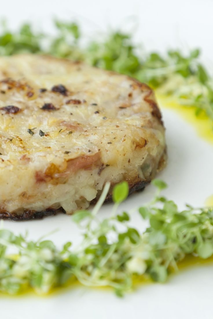 Adam Gray's bacon potato cakes recipe can be used to make a simple main or a more hearty breakfast. The richness of the egg yolk dressing perfectly offsets the saltiness of the bacon, and is a great salad dressing that could be used in many other dishes.