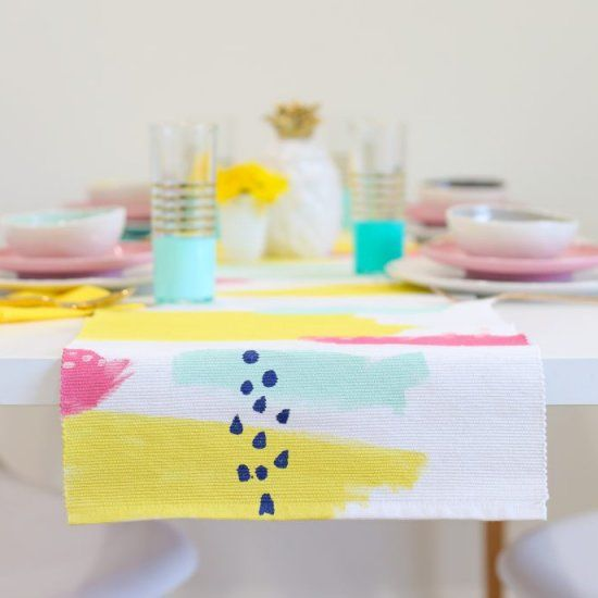 Spring has sprung (a little early) with this colorful DIY abstract painted table runner!