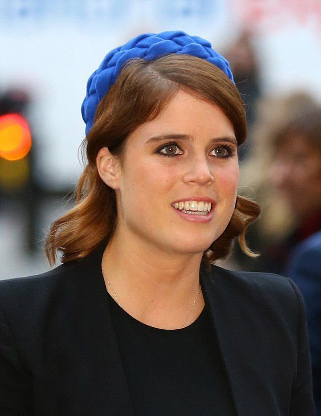 Princess Eugenie paired her dress with a simple black jacket and added a flash of color in the form of blue felt hat as she attended the service at Westminster Abbey on October 12, 2016